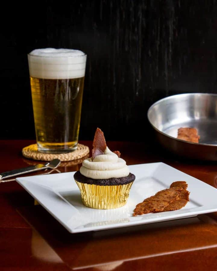 Vegan bacon cupcake on plate with beer in background