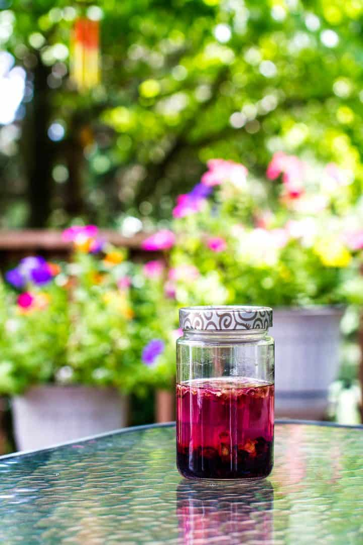 Jar of hibiscus vodka