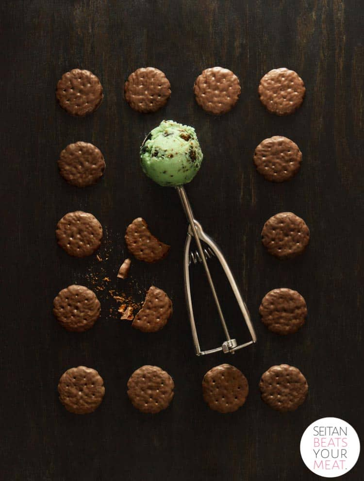 Thin Mint Ice Cream in scoop surrounded by grid of cookies on dark background