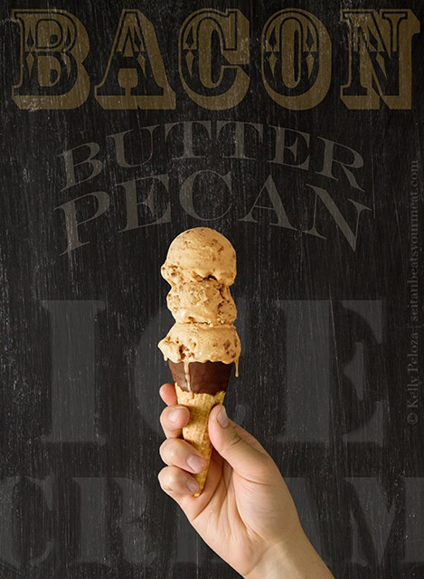 Hand holding chocolate dipped waffle cone with 3 scoops of bacon butter pecan ice cream