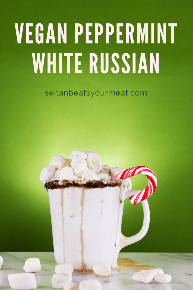 Mug of White Russian overflowing with a candy cane with green and marble background