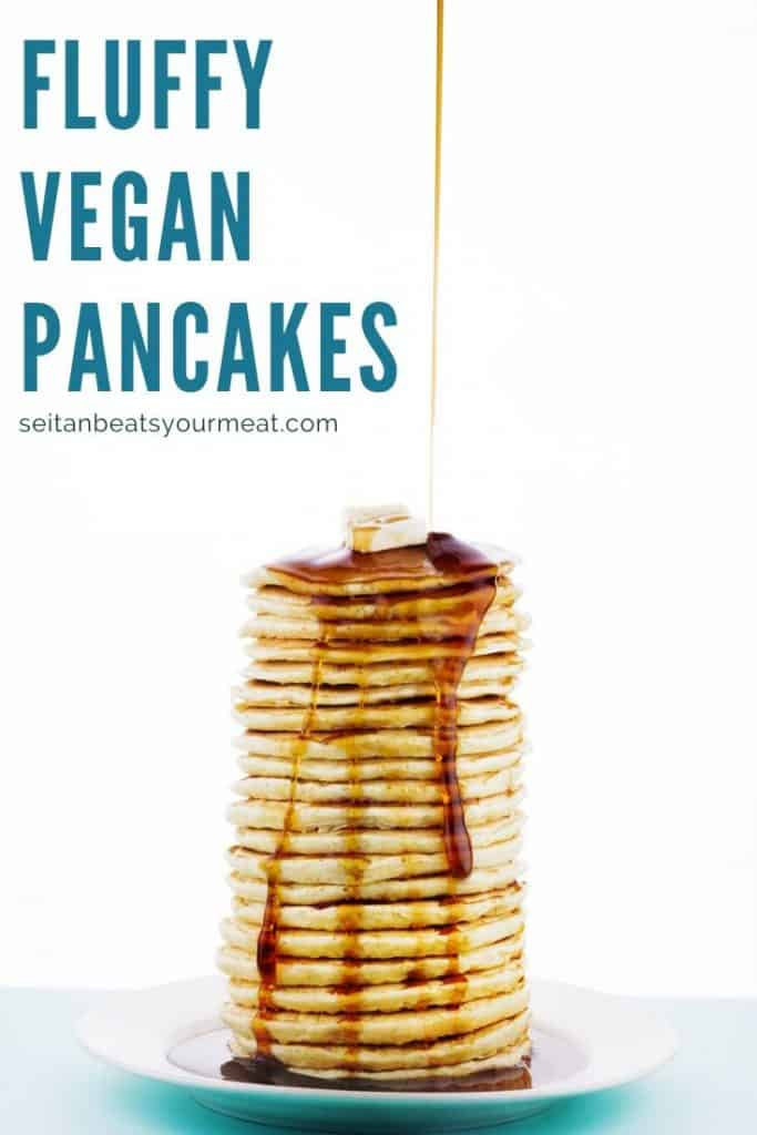 Tall stack of vegan pancakes with syrup