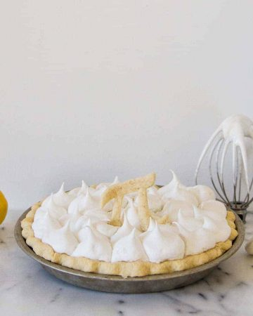 Vegan lemon meringue pie on marble
