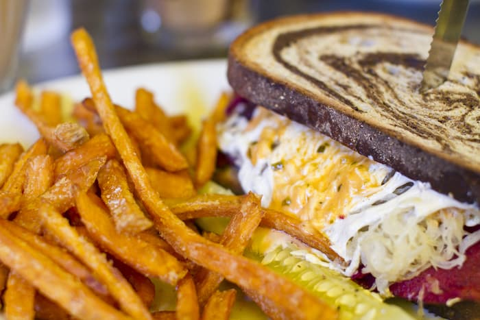 Close up photo of Chicago Diner Radical Reuben with sweet potato fries