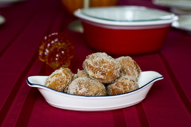 Bowl of Apple Cider Donut holes on a red tablecloth