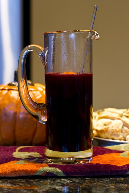 Mulled wine in a pitcher on a counter