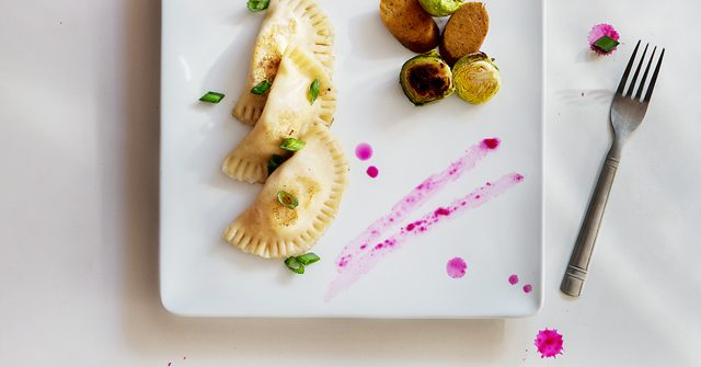 Potato and onion pierogi with beet horseradish, vegan kielbasa, and Brussels sprouts | Seitan Beats Your Meat