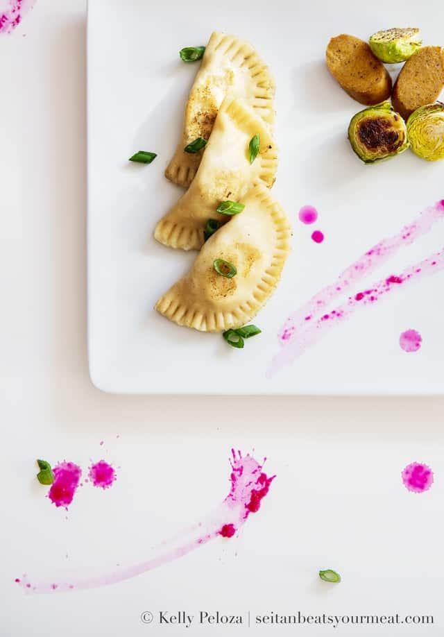 Potato and onion pierogi with beet horseradish, vegan kielbasa, and Brussels sprouts | Seitan Beats Your Meat