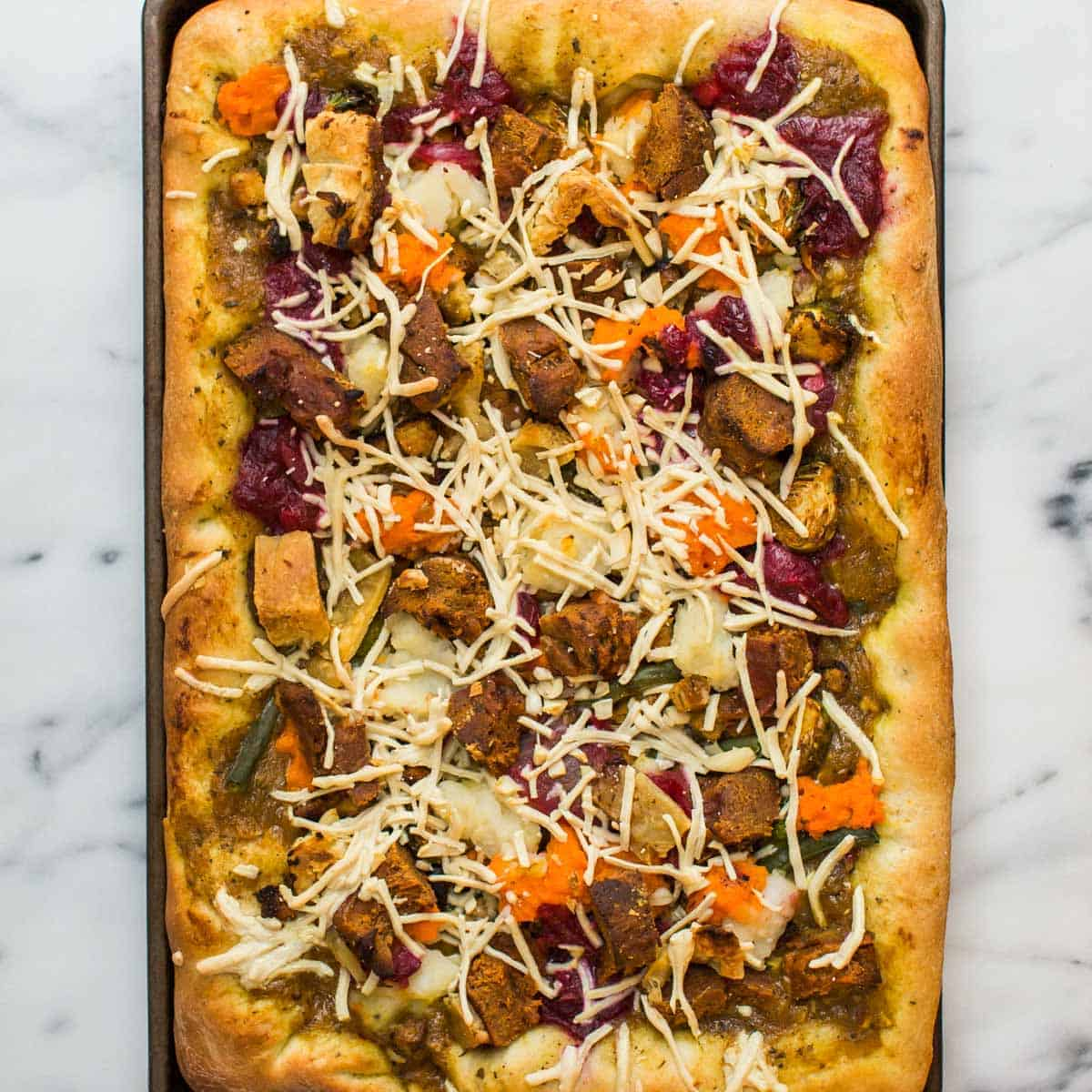 Thanksgiving leftovers pizza on marble counter