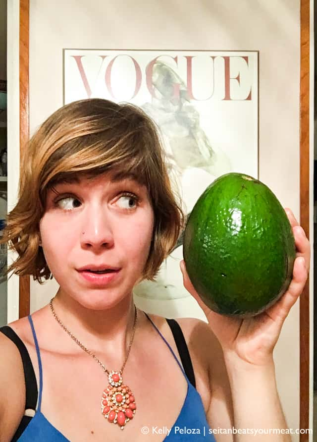 Woman holding large Puerto Rican avocado