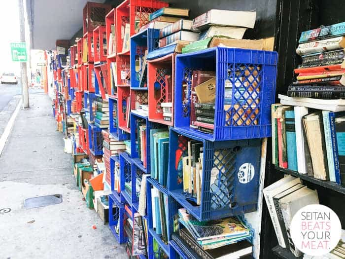 "Books in milk crates on street at ""Libros Libres"" free library"