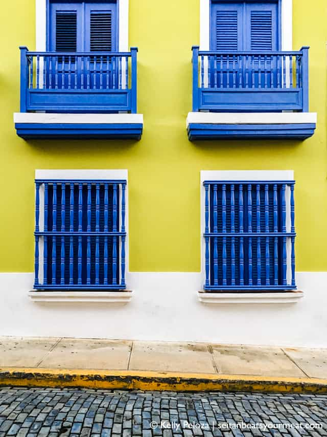 Yellow building with blue shutters in Old San Juan