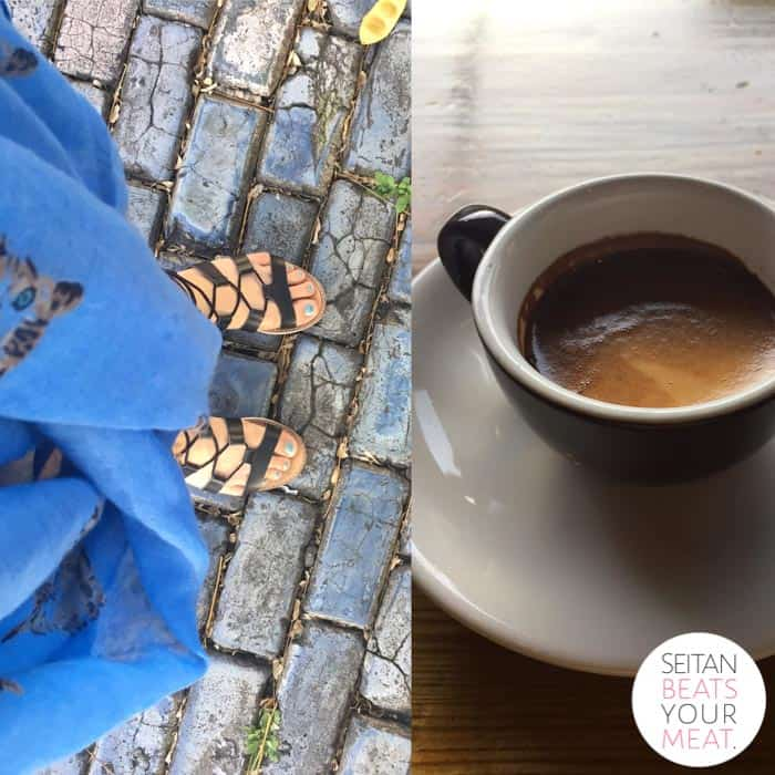 Feet in sandals on blue cobblestone in Old San Juan with cup of coffee
