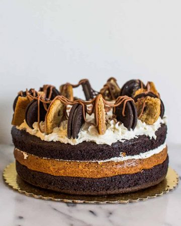 Three layer chocolate and cookie cake on marble counter