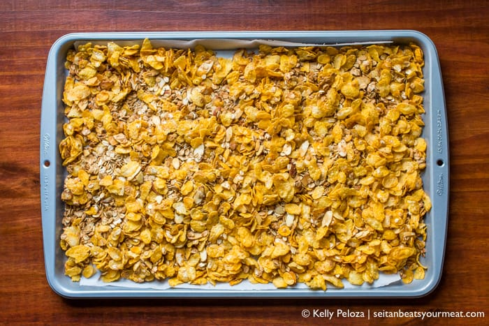 Vegan Honey Bunches of Oats cereal on baking sheet on wooden counter