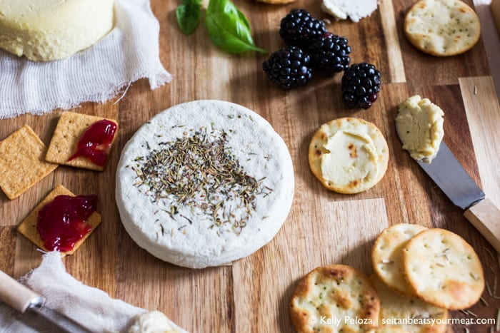 Vegan cheese board with focus on brie