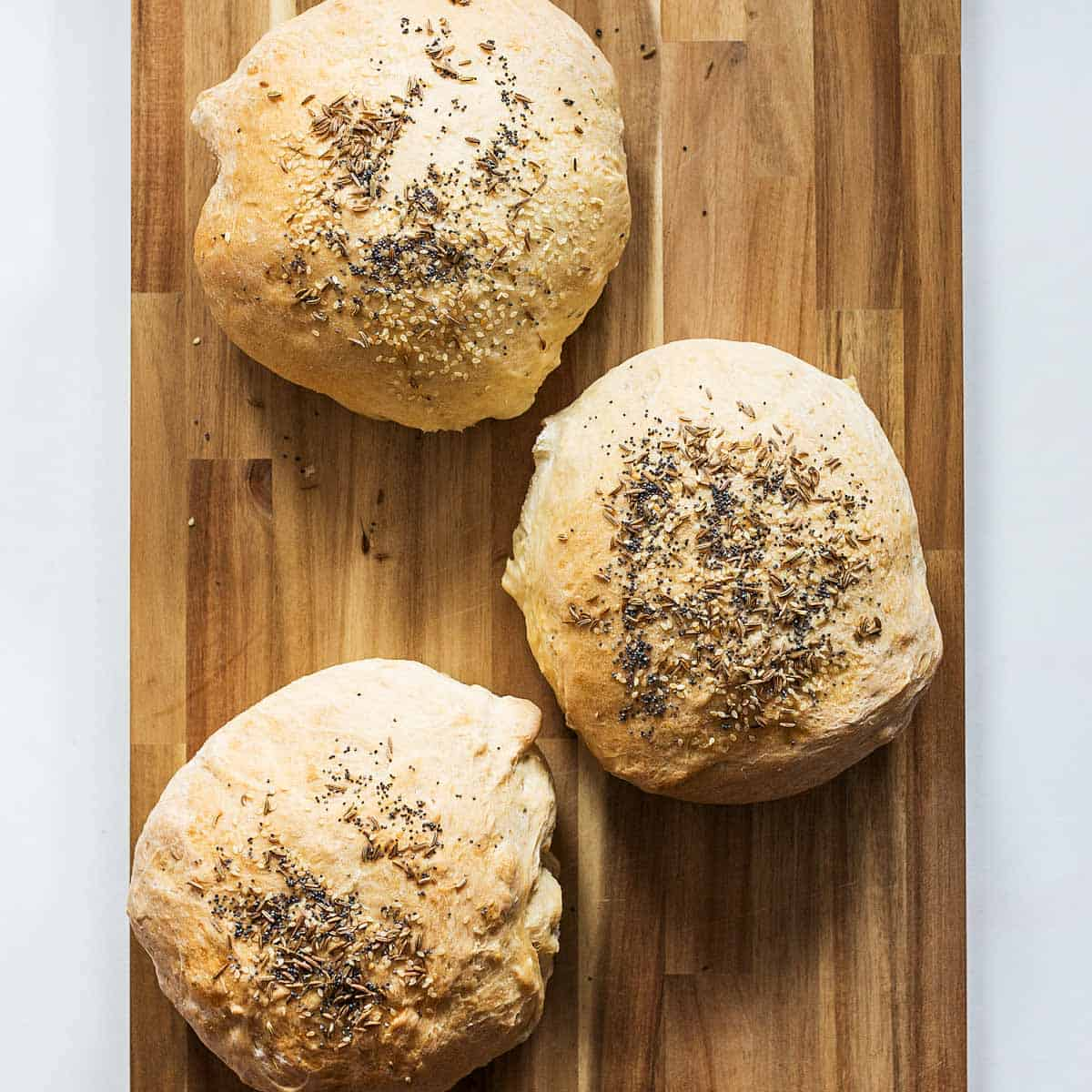 Homemade bread bowls on wooden board