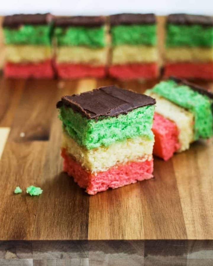 Italian rainbow cookies on wooden cutting board