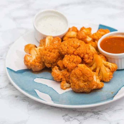 Plate of buffalo cauliflower on marble background