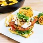 Veggie burger with plantain bun on plate with arroz con gandules