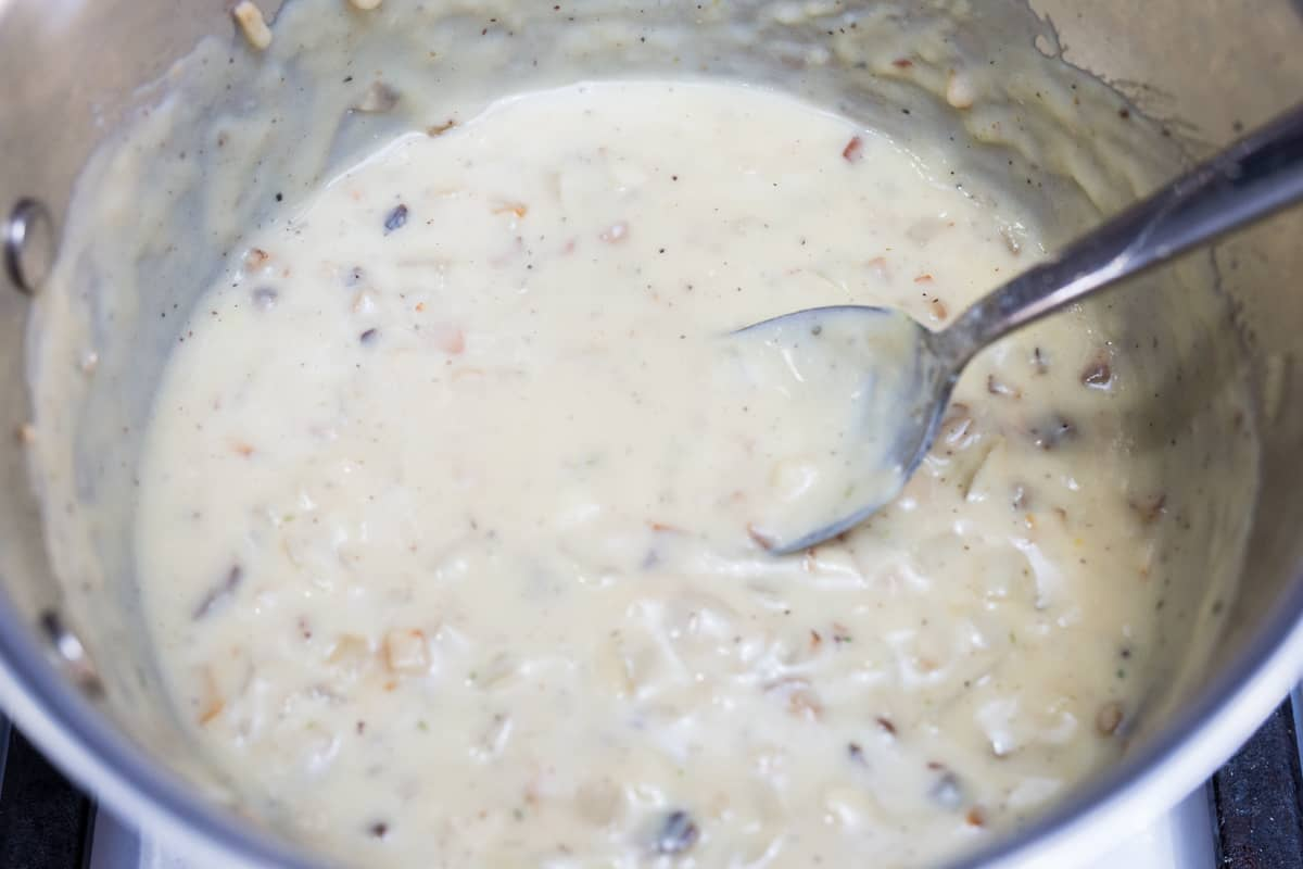 Close up image of cream of mushroom soup in pot