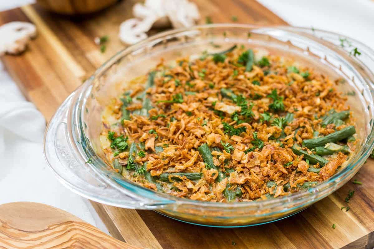 Close up image of vegan green bean casserole on wooden board