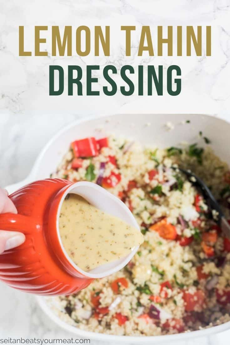Hand pouring dressing on quinoa in big bowl