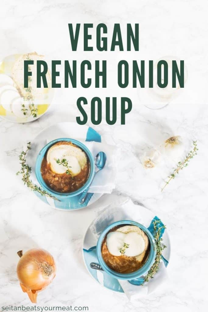 Overhead photo of 2 bowls of French onion soup on marble background