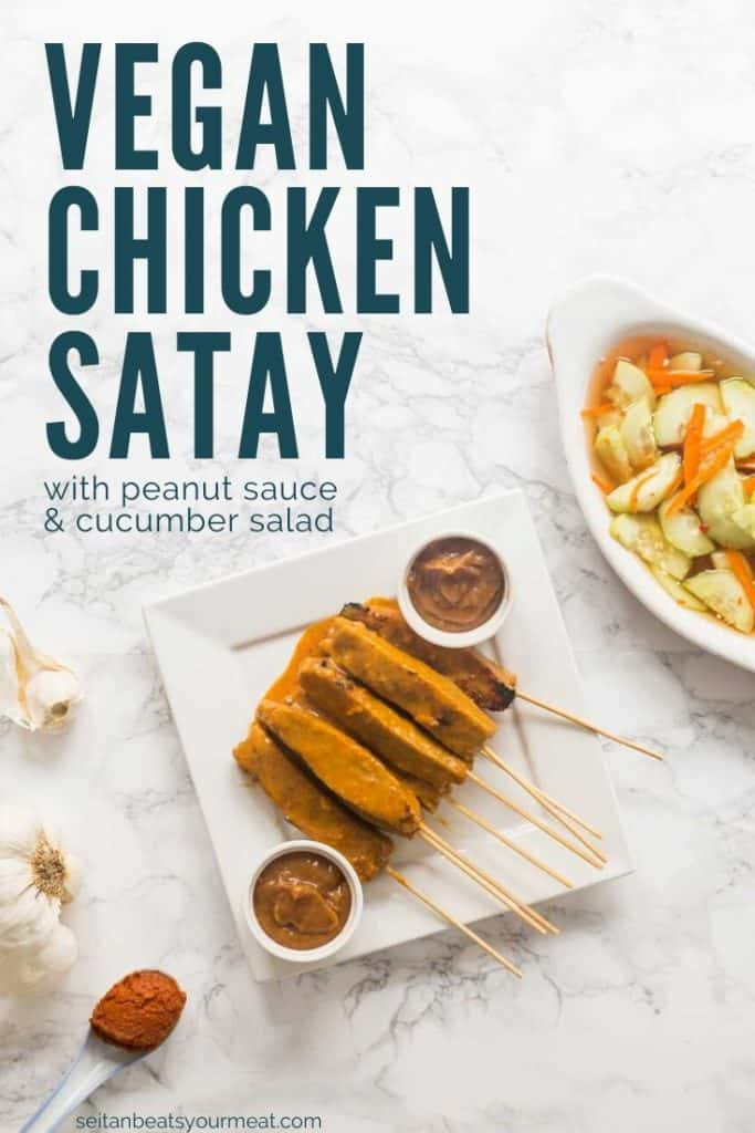"""Overhead photo of seitan satay with cups of peanut sauce, and cucumber salad on side with text """"Vegan Chicken Satay"""""""