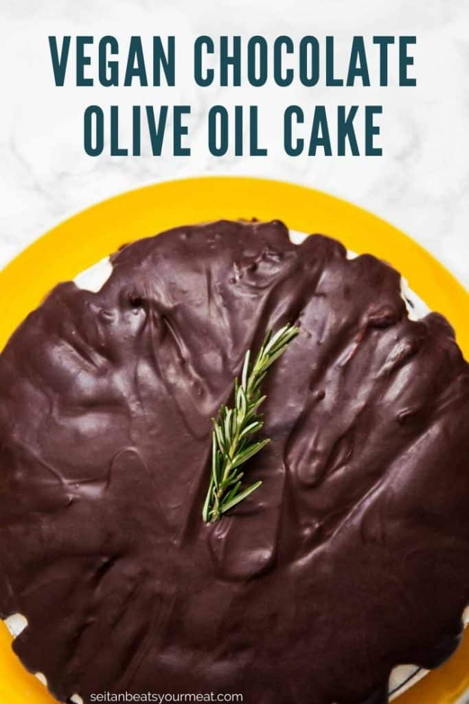 "Overhead photo of cake with chocolate ganache on yellow plate on white marble counter with text ""Vegan Chocolate Olive Oil Cake"""