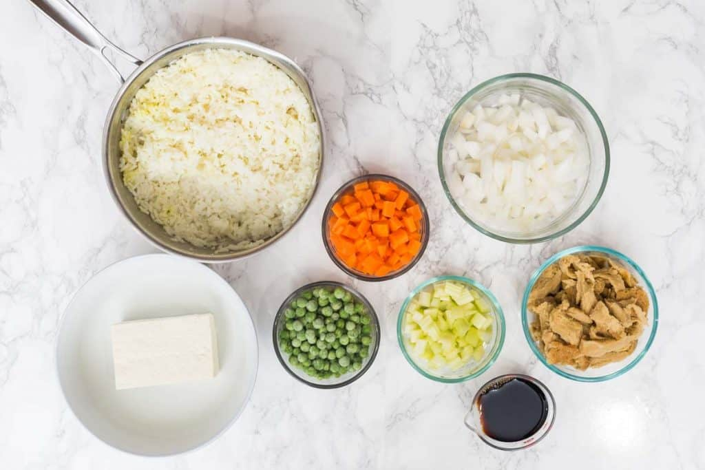 Overhead photo of rice and vegetables in small glass bowls