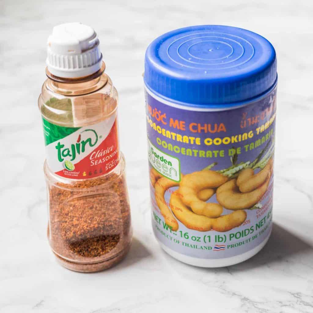 Bottle of Tajín and jar of tamarind concentrate
