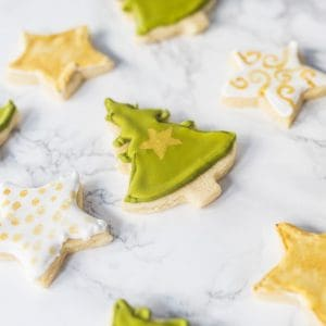 Tree and star-shaped sugar cookies with royal icing
