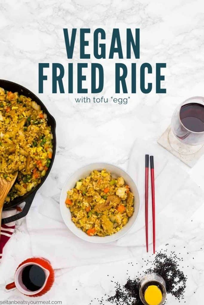 """Bowl of fried rice with red chopsticks with glass of wine with text """"Vegan Fried Rice with tofu egg"""""""