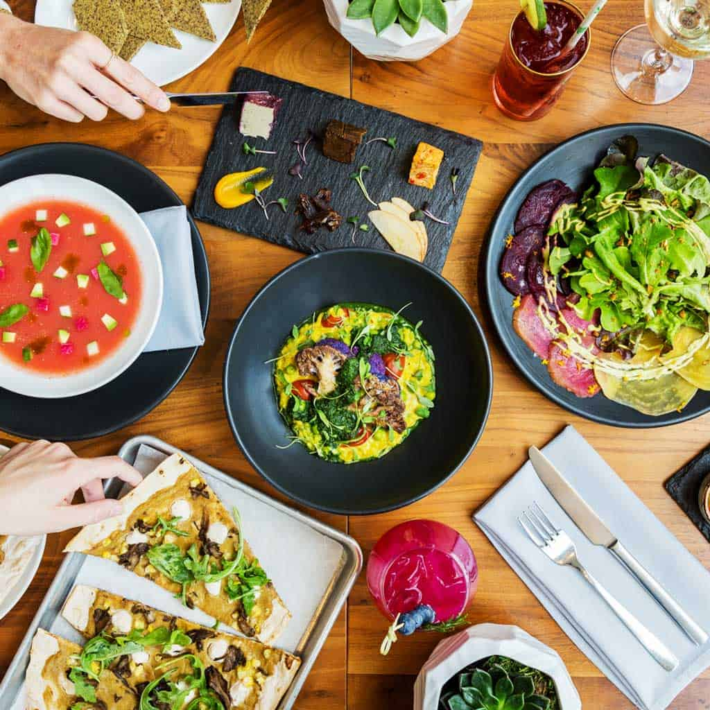Overhead photo of restaurant table with colorful dishes