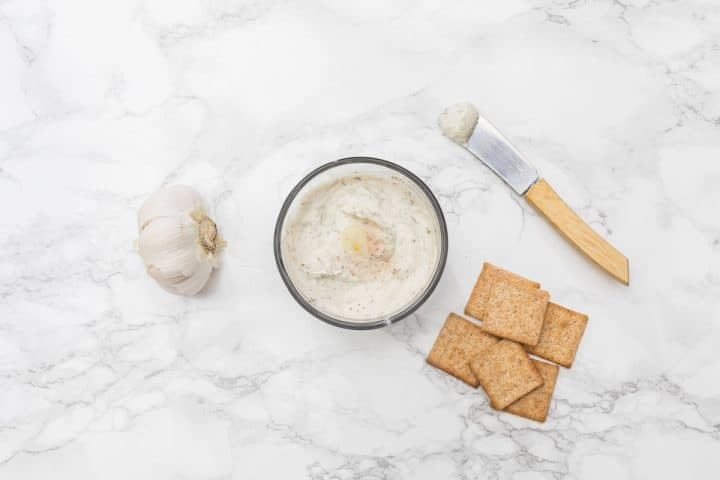 Small bowl of cheese with garlic and crackers