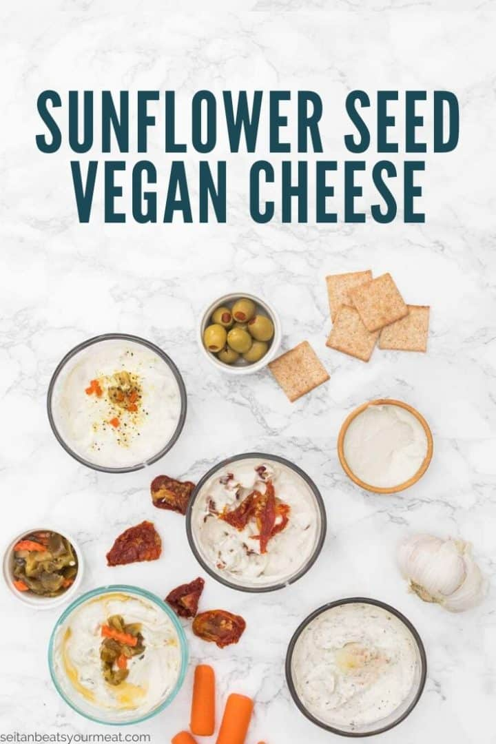 """Several small bowls of spreadable cheese with crackers and antipasto with text """"Sunflower Seed Vegan Cheese"""""""