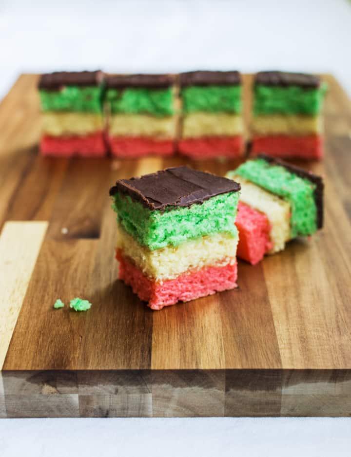 Italian rainbow cookies on cutting board