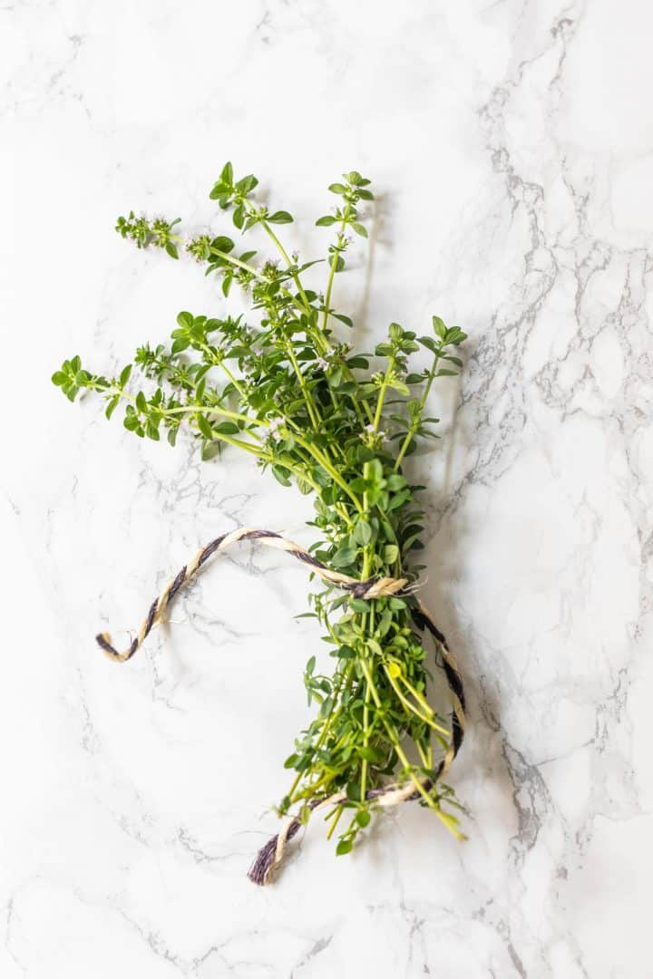 Bundle of fresh thyme tied together with twine