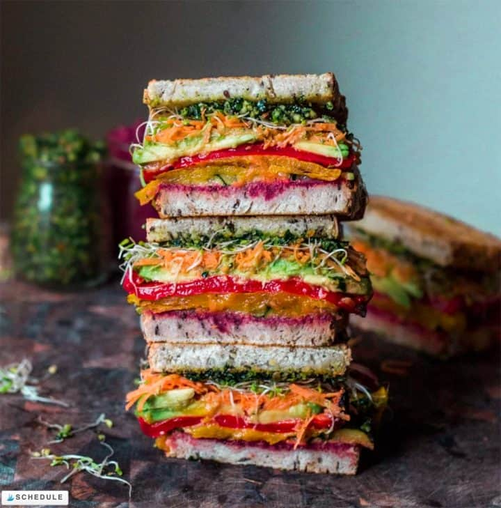 Stack of three colorful vegetable sandwiches