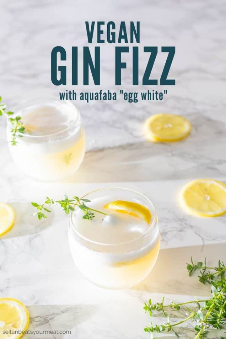 "Two gin cocktails with lemon slices and fresh thyme with text ""Vegan Gin Fizz with aquafaba egg white"""
