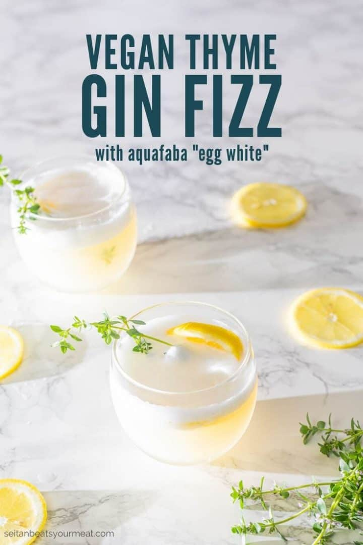 "Two gin cocktails with lemon slices and fresh thyme with text ""Vegan Thyme Gin Fizz with aquafaba egg white"""