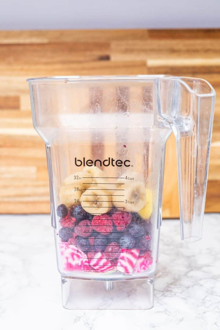 Banana, berries, and chopped beets in blender jar