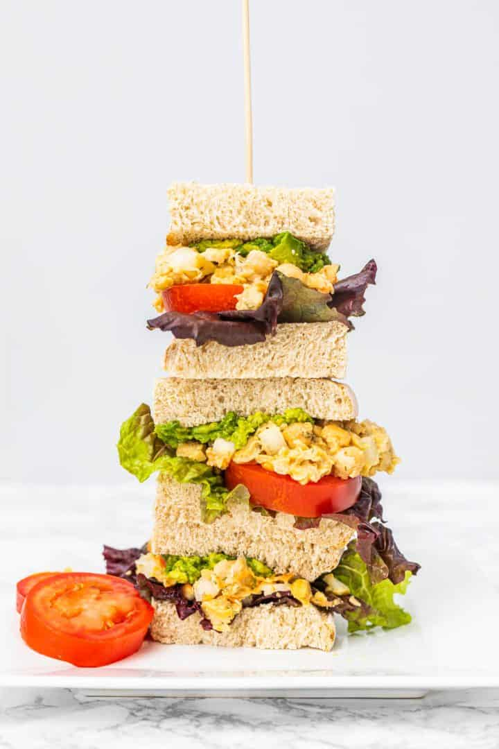 Stack of 3 sandwiches on plate
