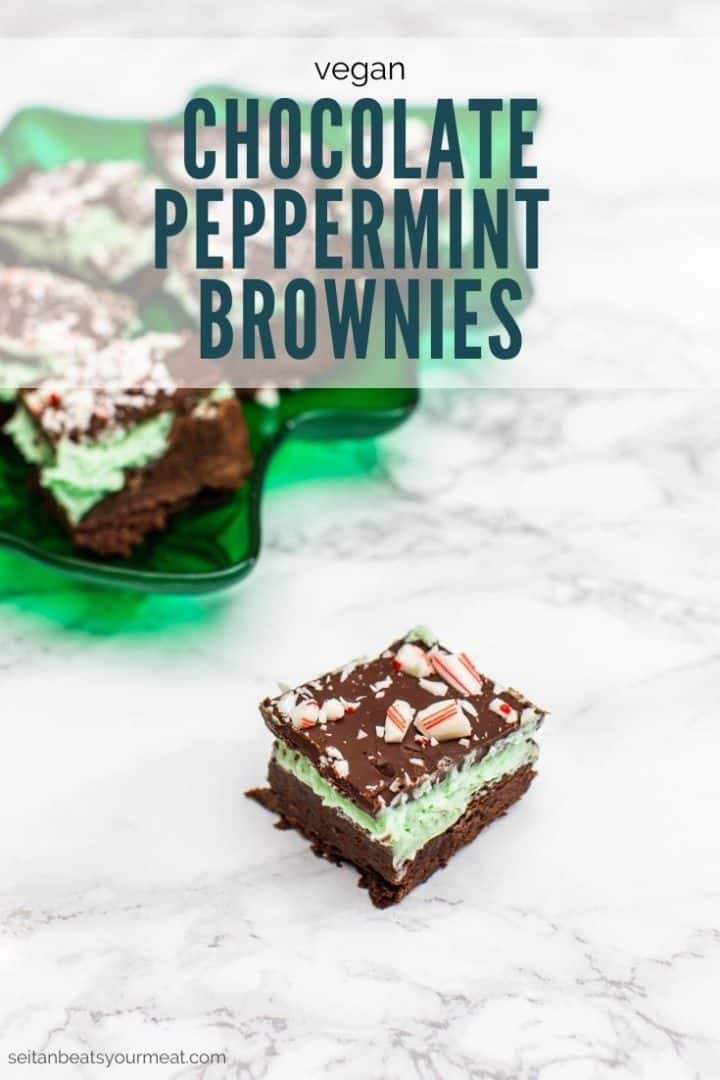 """Three layer chocolate brownies with green frosting and candy canes with text """"Vegan Chocolate Peppermint Brownies"""""""