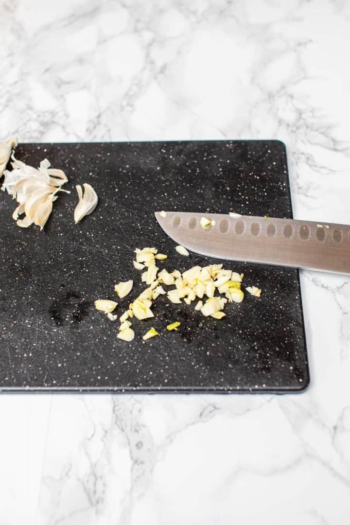 Chopped garlic on cutting board