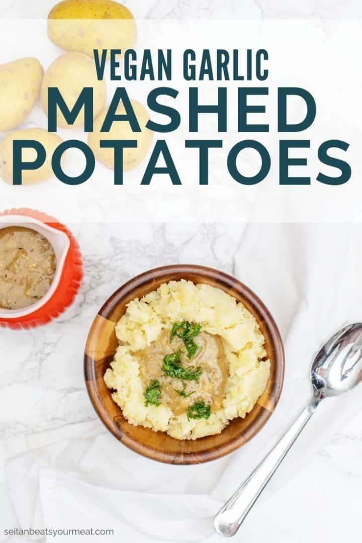 "Bowl of mashed potatoes and gravy with text ""Vegan Garlic Mashed Potatoes"""