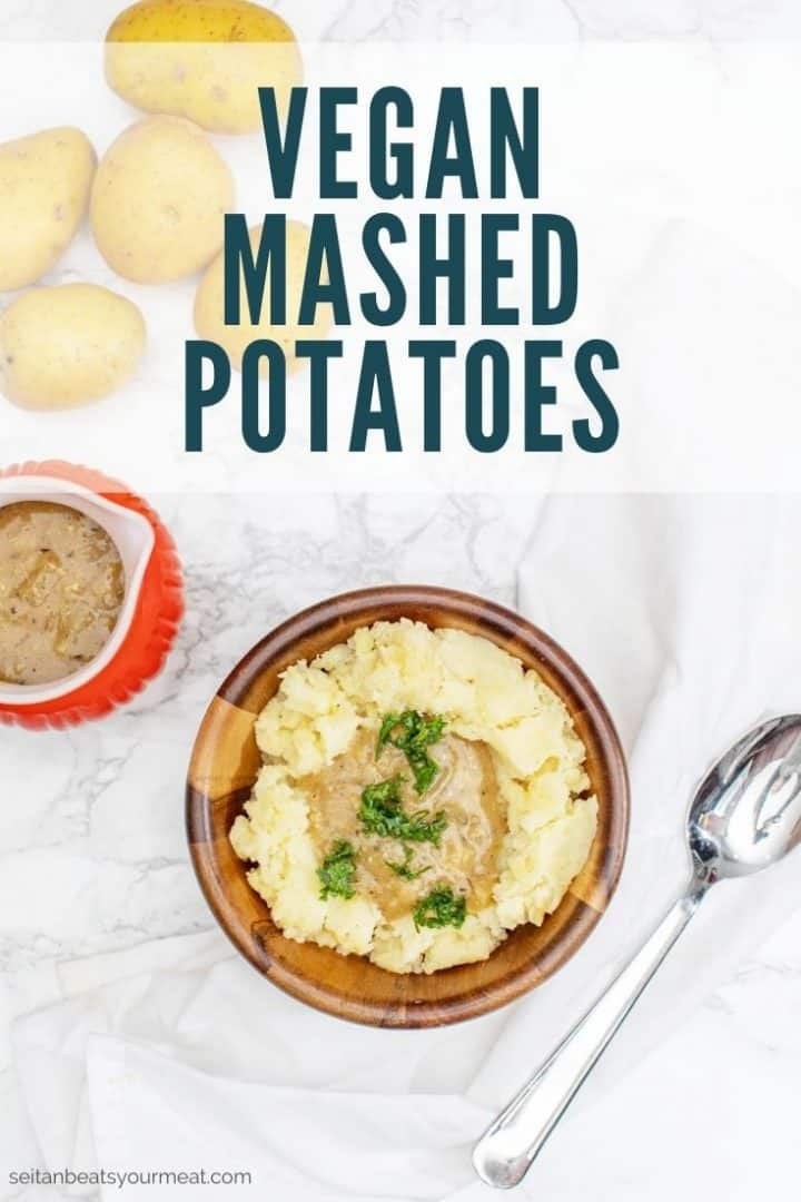 """Bowl of mashed potatoes and gravy with text """"Vegan Mashed Potatoes"""""""