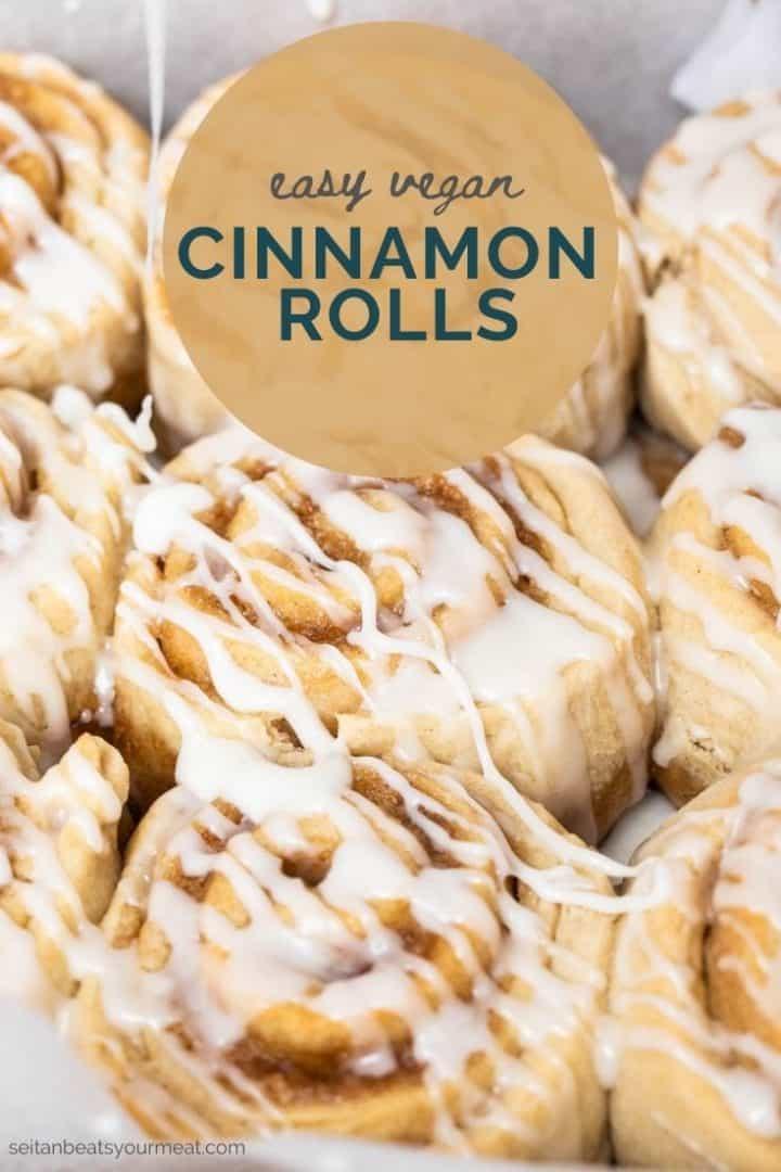 "Close up photo of glazed cinnamon rolls with text ""easy vegan cinnamon rolls"""