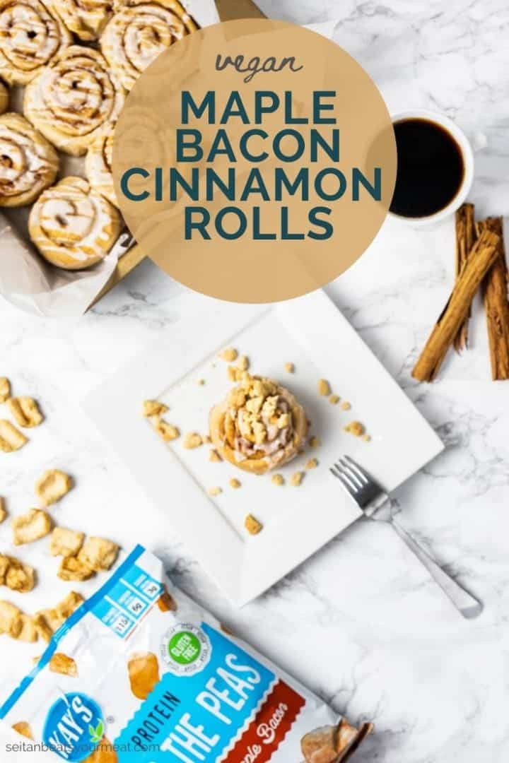 """Cinnamon roll on plate with coffee and bag of snacks with text """"vegan maple bacon cinnamon rolls"""""""
